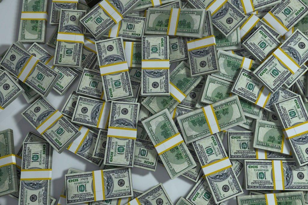 Photo of stacks of 100 dollar bills