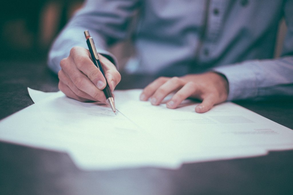 Photo of a man filling out documents
