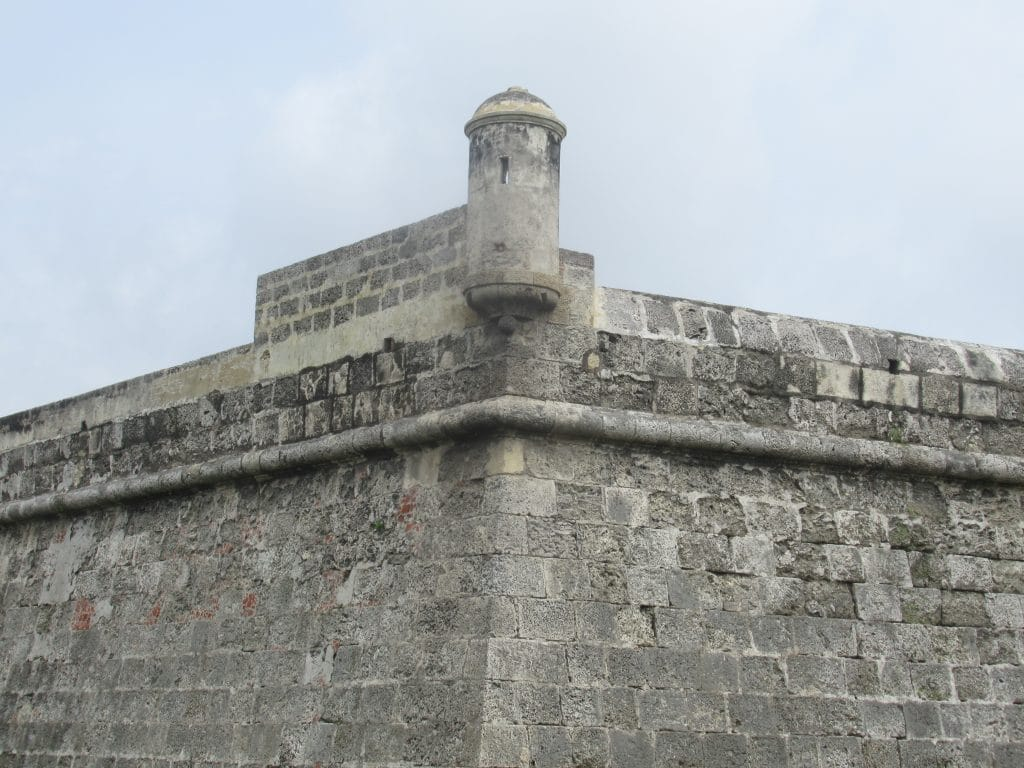 Photo of a corner of the historic wall in Cartagena, looking much how it might have looked during the Battle of Cartagena de Indias.