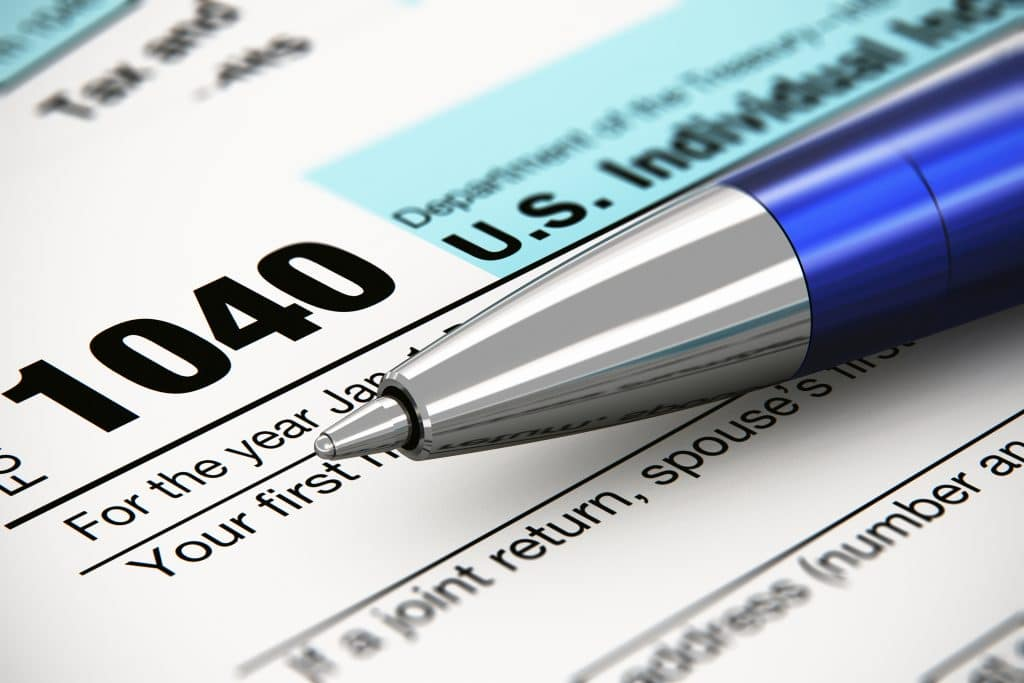 Photo of the tax form for expats with the tip of a ball point pen.