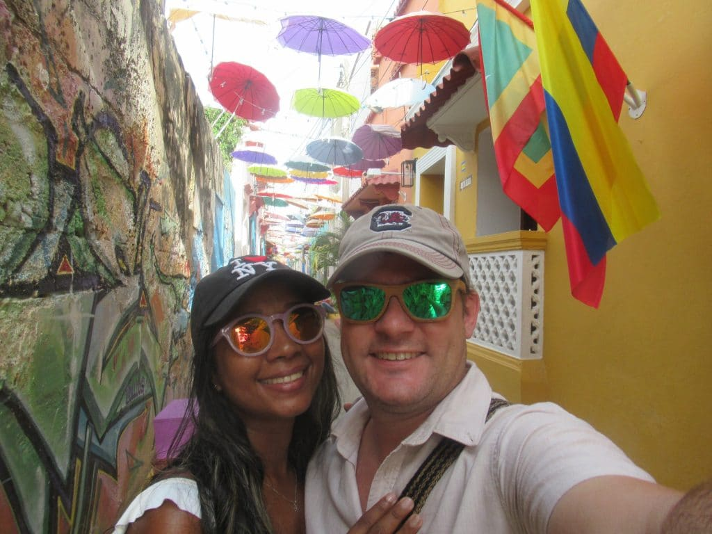 Photo of a couple on the Callejón Angosto, taking one fo the best photos in Cartagena as a selfie.