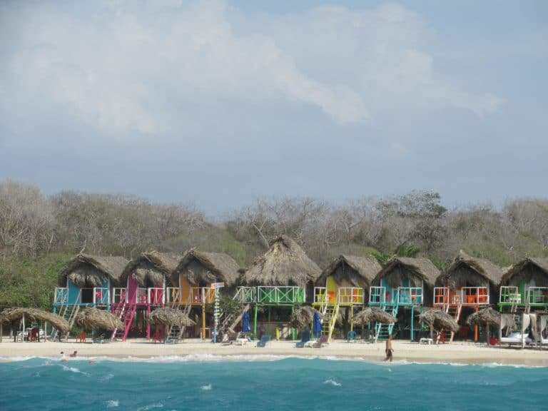 Photo of a group of colorful cabins on a Cartagena, Colombia beach.