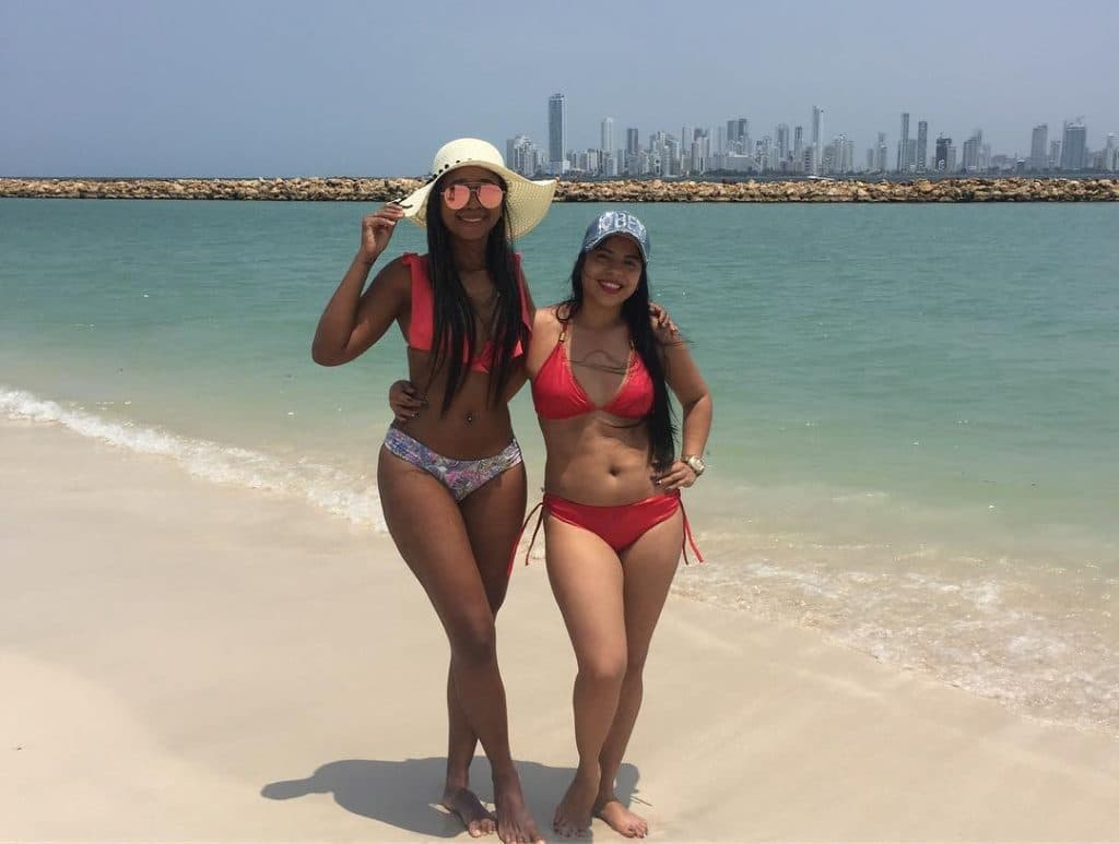 Photo of two girls on the beach in Tierra Bomba, another one of the top beaches in Cartagena.