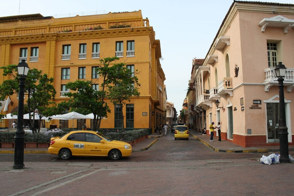 Photo of a street with Cartagena taxis.