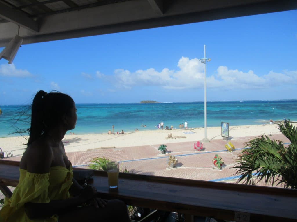 Photo of a girl looking out at the beach in the Isla San Andres, Colombia.