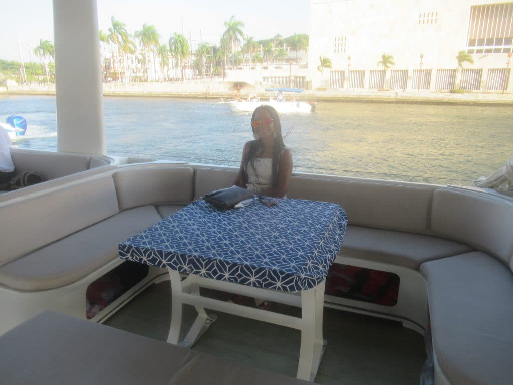 Photo of a girl sitting at one of the tables on the San Juan Catamaran in Cartagena.