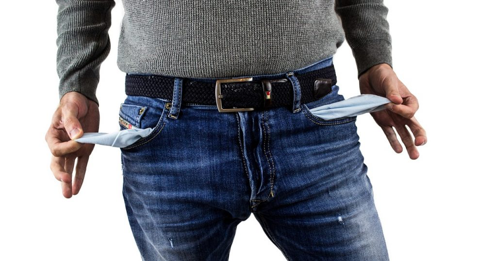 Photo of a guy with empty pockets, like you might feel if you are a US citizen living abroad waiting for your stimulus payments.