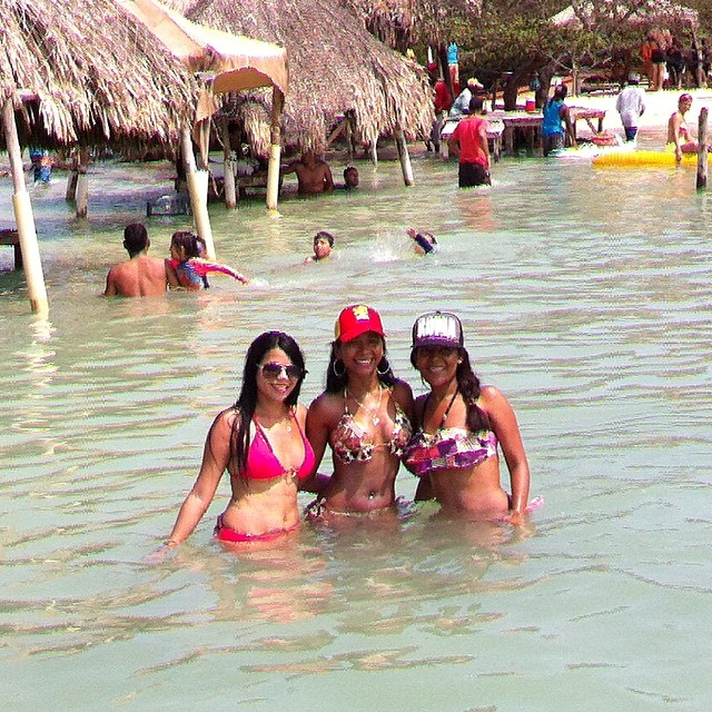 Photo of three girls in the water at Cholón Colombia.