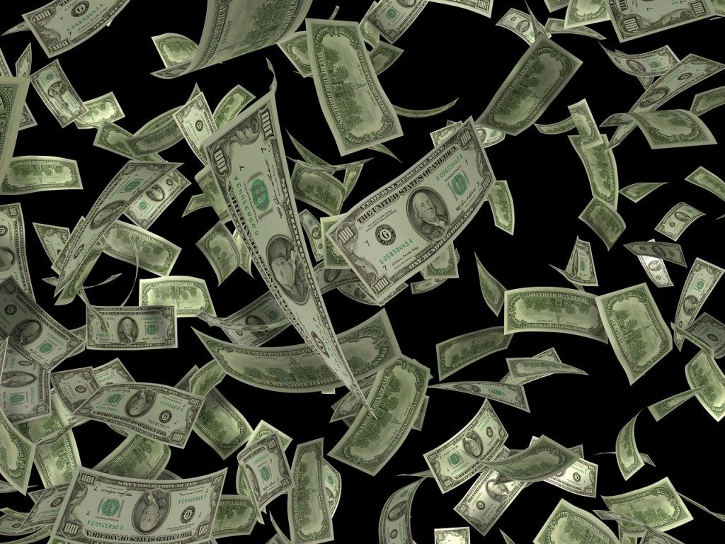Photo of cash raining down to represent the 2nd stimulus payment for citizens abroad