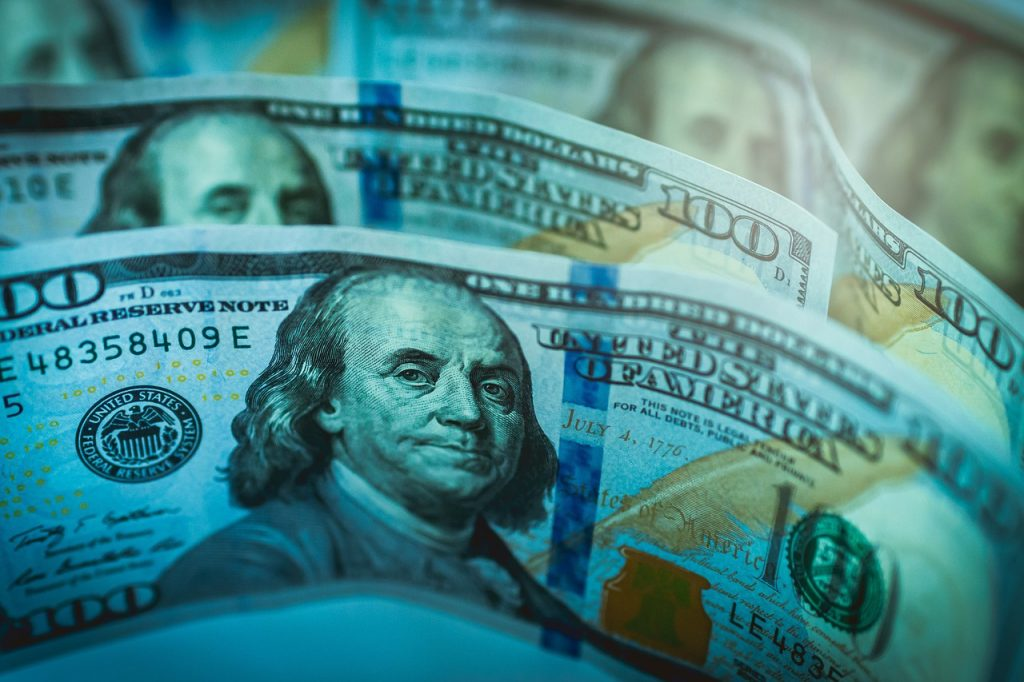 Photo of 100 dollar bills up close.