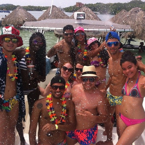 Group of people partying on a boat in Cholón Colombia.