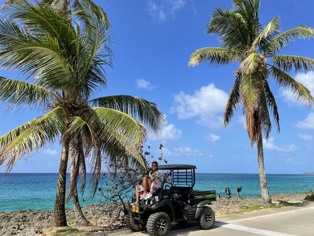 Photo of a girl sitting on a golf cart in San Andres Island, Colombia.