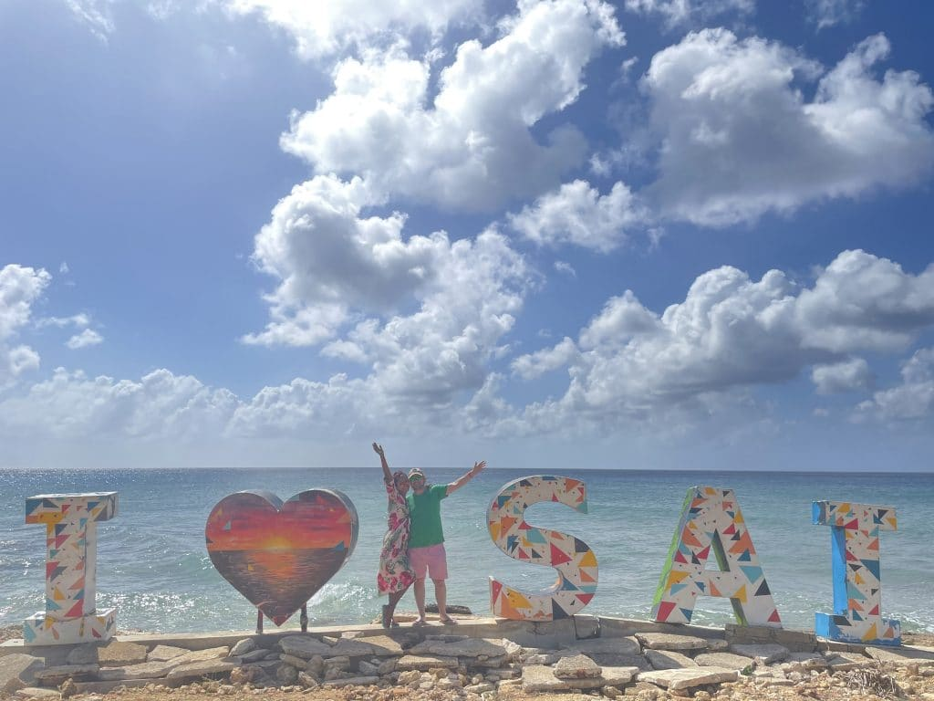 Photo standing with the I Love SAI sign on the island of San Andres, Colombia.
