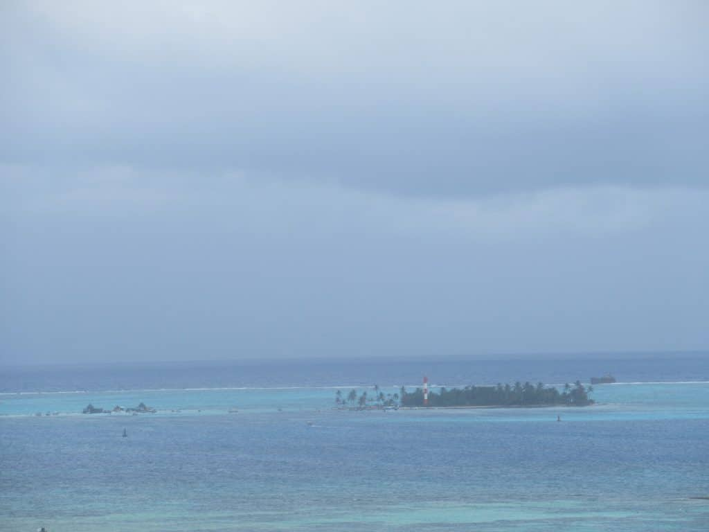 Photo of Haynes Cay and the San Andres Aquarium in the distance