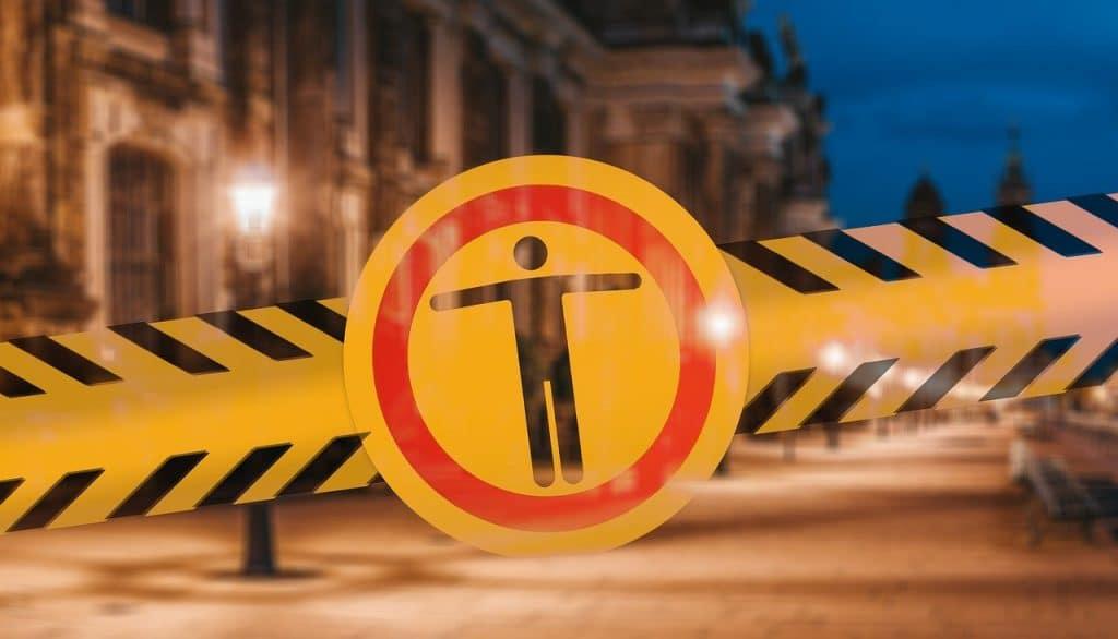 Photo of yellow tape blocking a street.
